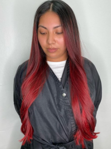 red long straight womans hair tribeca color salon tampa
