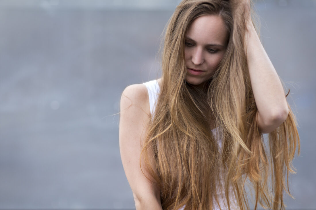 Woman long hair outdoors Tribeca Salons Blog